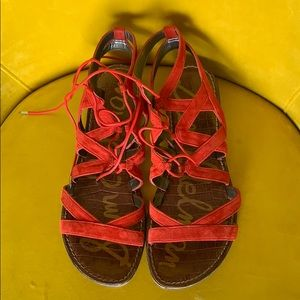 Red lace-up sandals